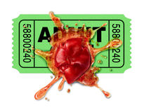 Bad Movies. Concept with a movie ticket and a squashed tomato that has been thrown to protest an awful film flop that was disappointing to watch and as a result Royalty Free Stock Image