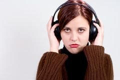 Bad music. Girl with headphones unhappy Stock Photography