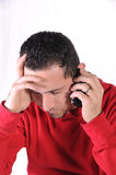 Bad new 2. A close up shot of a man receiving bad news Royalty Free Stock Images