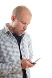 Bad News. Young man with mobile phone getting bad news Stock Image