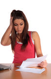 Bad news. An attractive young woman gets bad news via mail. All isolated on white background Stock Photography