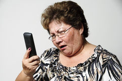 Bad news. An older Hispanic woman getting bad news on the phone Royalty Free Stock Images