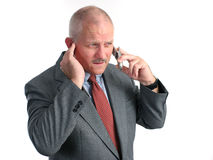 Bad News. A businessman on a cell phone, receiving bad news Stock Images
