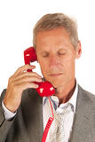 Bad news. Senior man is getting bad news on the phone Royalty Free Stock Photos