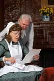 Bad news. Vintage scene of a Victorian couple reading bad news in a letter Royalty Free Stock Image
