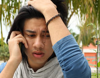 Bad News. Man receiving bad news on the phone Royalty Free Stock Photo