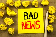 Bad News. Business concept for Failure Media Newspaper written on sticky note paper on the vintage background. Folded yellow paper. Bad News. Business concept Stock Photography