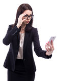 Bad news concept - surprised business woman looking at smart pho stock photography