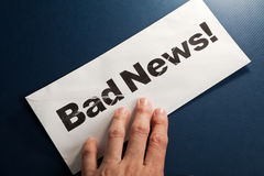 Bad News and envelope stock image