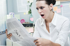 Bad news on financial newspaper Royalty Free Stock Photo