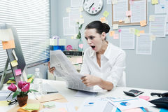 Bad news on financial newspaper Royalty Free Stock Image