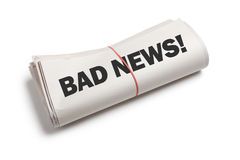Bad News. Newspaper roll with white background Royalty Free Stock Photos