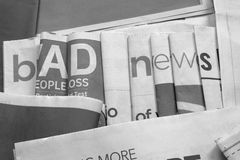 Bad news on newspapers black and white background Royalty Free Stock Photo