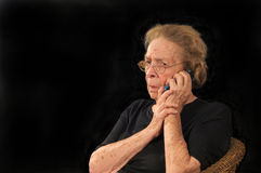 Bad news on phone. Grandmotherly woman hearing bad news on a cell phone Royalty Free Stock Photos