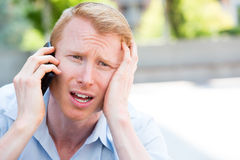 Bad news on phone Royalty Free Stock Photos