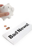 Bad News and Piggy Bank Stock Photography