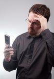 Bad news via mobile phone sms Stock Photography