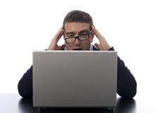 Bad news worker. Stressed worker reading bad news on his laptop stock photo
