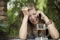 Bad news. Young girl is devastated with bad news she is receiving on her phone stock images