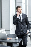 Bad news. Young successful businessman talking on his mobile pho Royalty Free Stock Image
