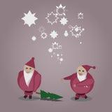 Bad and Nice Santa. Bad Santa in the pursuit of a good Santa, but good always wins Stock Photography