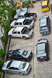 Bad parking. Typical parking lot in Thailand. Blocking other cars is allowed if you leave your car with no gear and no handbrake, thus allowing people to push Stock Photos