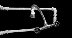 Bad piping. Water tap bad piping isolated on black Stock Image