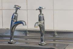 Bad plumbing. Limescale on old chrome tap. Selective focus royalty free stock images