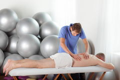 Bad posture of masseur during massage Royalty Free Stock Photo