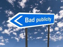 Bad publicity. Highway style blue sign board with text 'Bad publicity' in white letters, blue sky and cloud background royalty free stock photography