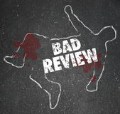 Bad Review Words Chalk Outline Killed by Criticism Negative Feed. Bad Review words on a chalk outline for a dead body of a person killed by negative feedback Stock Photography