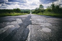 Bad road with damaged and broken asphalt, Difficult life concept. Bad road with damaged and broken asphalt, Difficult life and problems concept Stock Image