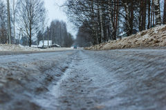 Bad road - the slippery track was not cleared in time to municipal service. Municipal service time has not removed the snow and got this bad and dangerous road Royalty Free Stock Images