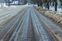 Bad road - the slippery track was not cleared in time to municipal service. Municipal service time has not removed the snow and got this bad and dangerous road Stock Photo