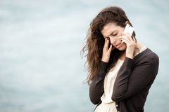 Bad sad news by phone Stock Photo