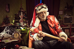 Bad Santa with bad Christmas gift Royalty Free Stock Photography