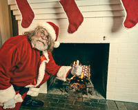 Bad Santa Burning Gifts In The Fireplace Stock Photo