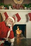 Bad Santa Burning Gifts In The Fireplace stock photos