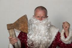 Bad Santa Claus with an ax. The concept of fun and unexpected advertising.  Stock Image