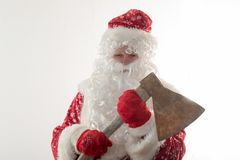 Bad Santa Claus with an ax. The concept of fun and unexpected advertising.  Royalty Free Stock Photo