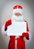 Bad Santa Claus. Bad Santa Claus is holding white blank Royalty Free Stock Photography