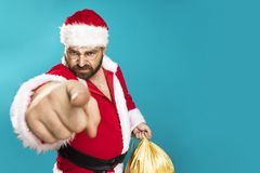 Bad Santa Clous Man. Bad Santa Claus pointing on you, concept christmas Stock Photo