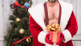 Bad Santa Clause. With New Year gift is nice present for any girl or woman for New Year or Christmas. New Year celebration or holiday concept Stock Images
