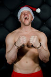 Bad Santa in handcuffs. Royalty Free Stock Image
