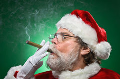 Bad Santa Lighting A Cigar Royalty Free Stock Photography