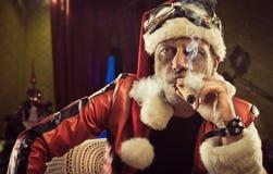 Bad Santa smoking a cigar Royalty Free Stock Photography