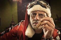 Bad Santa smoking a cigar Stock Image