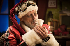 Bad Santa smoking a joint Stock Image
