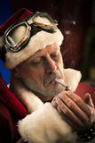 Bad Santa smoking a joint Stock Photography