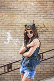 Bad sexy woman with leather cat ears showing fingers Stock Photos